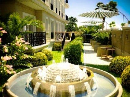 شقة للبيع دور أرضى مساحة 140م2 تشمل حديقة 55م2 امام مدينتى