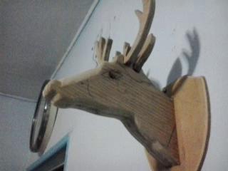 نحت بالخشب (غزالة منحوتة بالخشب)