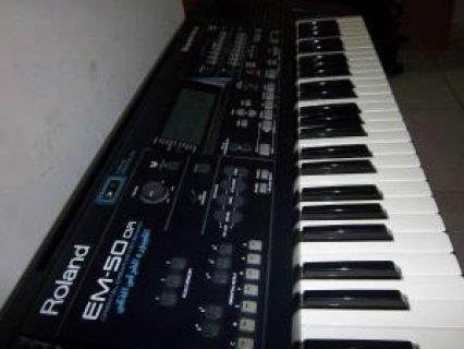 للبيع  piano Roland Em 50