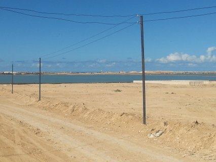 للبيع قطعه ارض للمستقبل تطل على بحيره مريوط