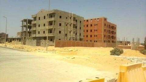 ارض15575 متر لانشاء مشروع عقارى بطريق الفيوم على امتداد تل عمران
