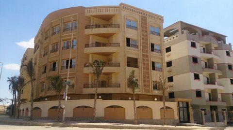للتملك شقة بالنرجس عمارات 285 م2 نصف تشطيب