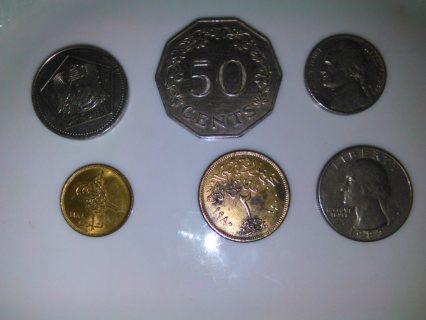 عملات معدنية من بلاد مختلفة قديمة