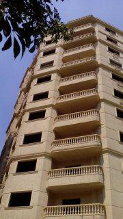 شقة للبيع بالمهندسين بشارع شهاب ببرج حديث