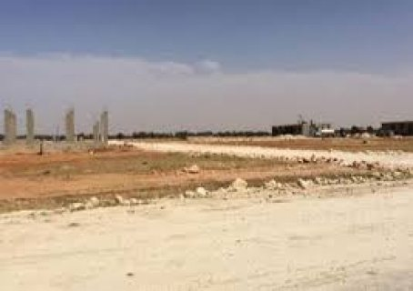 قطعة ارض للبيع لقطة بالتوسعات الشمالية 455 م على مساحة خضراء