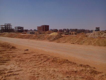 أرض بالتوسعات 457م مبنى بدروم ومدفوع قسط
