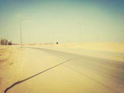 ارض ناصيه عليى محور التحرير ببيت الوطن الحي التاسع