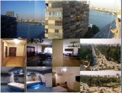 شقة تشطيب فاخر للبيع بموقع وفيو متميز على النيل بالجيزة